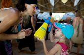 Ozora, Hungary - August 01: Little Girl Spray Water On A Woman On Ozora Festival, One Of The Greates