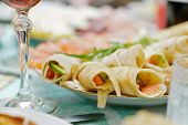 Pancake Wraps With Salmon And Cucumber On A Russian Festive Table