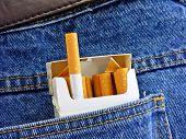 Cigarettes in jeans back pocket