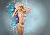 Young pretty blonde woman in hat and bikini