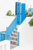 Architecture On The Cyclades. Greek Island Buildings With Her Typical Blue Doors And White Houses.
