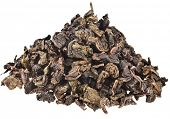 Heap pile of Tea Tie Guan Yin Oolong slightly fermented isolated on white background