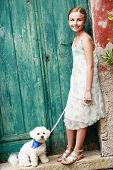 Portrait of lovely girl with dog