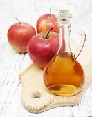 pic of cider apples  - Apple cider vinegar and fresh apple on a wooden background - JPG