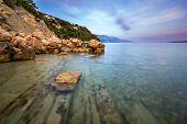Rocky Beach And Transparent Adriatic Sea Near Omis In The Evening, Dalmatia, Croatia