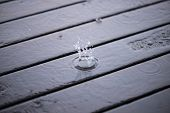 Splashing Rain Water Droplets On Wooden Deck