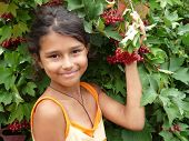 The Girl Standing Beside A Red Viburnum