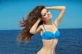 Happy Smiling Summer Girl With Long Wavy Blowing Hair. Wellness. Seaside.