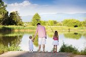 Happy father and daughters fishing