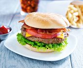 bacon cheeseburger meal with cola and fries