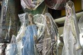 BELO HORIZONTE, BRAZIL - JULY 28: Religious icons wrapped in plastic in Brazilian market. The saints
