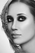Black and white close-up portrait of young beautiful woman with stylish smoky eyes