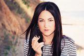 Beautiful Young Woman Who Smokes A Cigarette