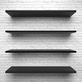 Empty black shelves isolated on white brick background.