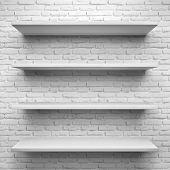 Empty four shelves on white brick background.