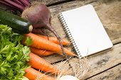 Recipe Background. Fresh Vegetables With Blank Page Of Cookbook