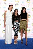 LOS ANGELES - AUG 10:  Kendall Jenner, Kim Kardashian, Kylie Jenner at the 2014 Teen Choice Awards at Shrine Auditorium on August 10, 2014 in Los Angeles, CA