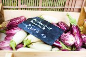Fresh Eggplants, Aubergine Vegetables On Street Market In Provence, France.
