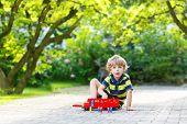 Little Preschool Boy Playing With Car Toy