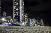Gold Coast cityscape and famous beach by nigh