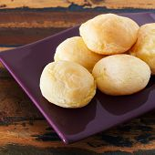Brazilian Snack Cheese Bread (pao De Queijo) On Purple Plate