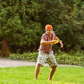 stock photo of frisbee  - man playing in the park with a plate frisbee - JPG