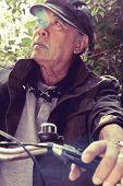 senior asian man riding his bicycle