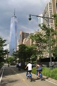 Unidentified bicycle riders near Freedom Tower in NY