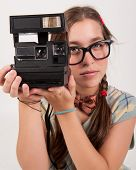 Young Nerdy Photographer Holding An Instant Camera.