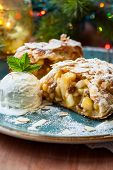 Apple strudel with icing sugar,almonds and vanilla ice cream for Christmas
