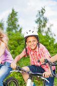 Happy boy in helmet riding a bike