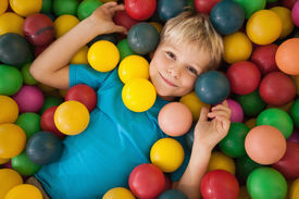 picture of pool ball  - Happy boy playing in ball pool at a party - JPG