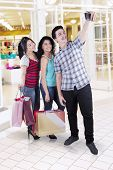 Multiracial Group Of Friends Taking Photo In Mall