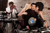 foto of groupies  - Enviable Asian DJ with admiring female friends - JPG