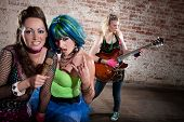 image of groupies  - Young all girl punk rock band performing - JPG