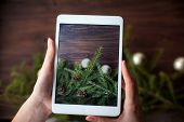 Taking Picture With Tablet On Wooden Background