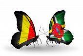 Two Butterflies With Flags On Wings As Symbol Of Relations Belgium And Dominica