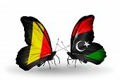 Two Butterflies With Flags On Wings As Symbol Of Relations Belgium And  Libya