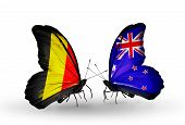 Two Butterflies With Flags On Wings As Symbol Of Relations Belgium And New Zealand