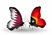 Two Butterflies With Flags On Wings As Symbol Of Relations Qatar And East Timor