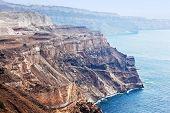 Cliff and volcanic rocks of Santorini island, Greece. Caldera and Aegean sea