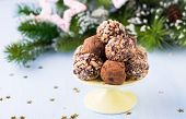 stock photo of truffle  - Assorted dark chocolate truffles on cake stand festive decorations selective focus - JPG