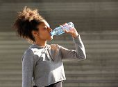African American Sports Woman Drinking From Water Bottle