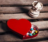 Gingerbread hearts in a heart shaped box with music box