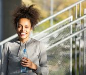 Happy Young Woman Smiling With Water Bottle