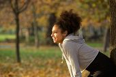 Young Woman Smiling And Resting After Workout In The Park