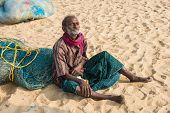 CHENNAI INDIA - FEBRUARY 10: An unidentified man sits on the sand near the Marina Beach on February