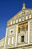 The San Miniato al Monte church in sunset, view from the front, in Florence, Italy