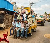 Thanjavour, India - February 13: An Unidentified Men And Woman Riding In A Truck On A Rural Road In