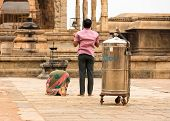 Thanjavur, India - February 14: Indian Man And  Woman Prays At Brihadishwara Temple. India, Tamil Na